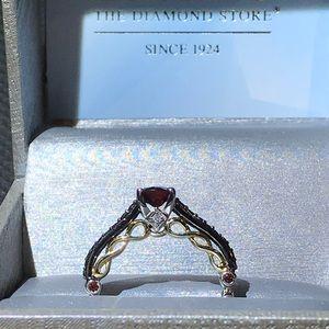 Ladies garnet ring .925 & 10kt